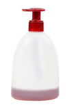 Cosmetic bottle with red cap Stock Image