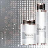 Cosmetic bottle on silver background Stock Images