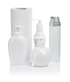 Cosmetic bottles paper towels Royalty Free Stock Image