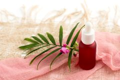 Cosmetic bottles, pink oil jars, royalty free stock image