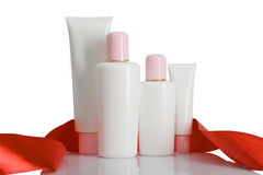 Cosmetic bottles with tape Royalty Free Stock Photos