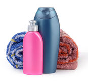 Cosmetic bottles and towels Royalty Free Stock Photos