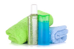 Cosmetic bottles with towels Stock Image