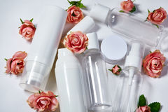 Cosmetic bottles. Wellness and spa bottles collection with spring parfume flowers. Beauty treatment, bathroom set. royalty free stock images