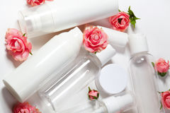Cosmetic bottles. Wellness and spa bottles collection with spring parfume flowers. Beauty treatment, bathroom set. Royalty Free Stock Photography
