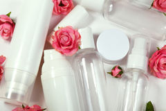 Cosmetic bottles. Wellness and spa bottles collection with spring parfume flowers. Beauty treatment, bathroom set. Royalty Free Stock Photo