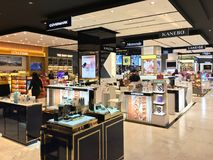 Cosmetic boutiques in Central World mall, Bangkok. BANGKOK - DECEMBER, 2017: Cosmetic boutiques in Central World mall. Central World is the tenth largest Stock Images