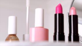 Cosmetics, makeup products on dressing vanity table, lipstick, brush, mascara, nailpolish and powder for luxury beauty