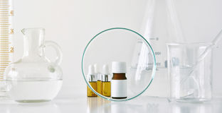Cosmetic brown bottle containers and scientific glassware, Focus on blank label package for branding mock-up Stock Images