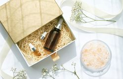 Free Cosmetic Brown Bottle Containers With Ribbon And Gift Boxes. Stock Photos - 93532643