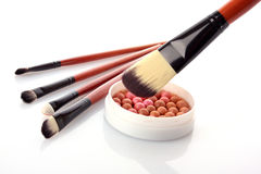 Cosmetic brush. On cosmetics background Royalty Free Stock Photos