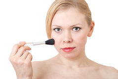 Cosmetic brush. Women with Cosmetic brush for applying the powder Stock Photo