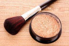 Cosmetic brush. And powder on the table Royalty Free Stock Photography