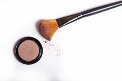 Cosmetic brush and blush powder isolated. On white royalty free stock image