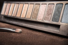 Cosmetic brush with colorful shade powder.  Royalty Free Stock Photos
