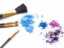 Cosmetic brush and colors powder on white background. Cosmetic brush and colors powder on white background Royalty Free Stock Photo