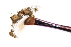 Cosmetic brush and crushed mixed color eyeshadow Royalty Free Stock Image