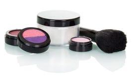 Cosmetic brush, eye shadow, blush and cream isolated on white. Royalty Free Stock Image