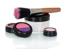 Cosmetic brush, eye shadow, blush and  jar of cream isolated. Stock Photos