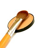 Cosmetic brush and face powder isolated on white Royalty Free Stock Photography