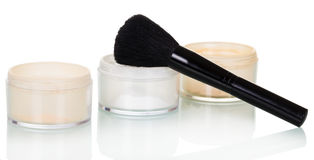 Cosmetic brush and jars with powder  on white. Cosmetic brush and jars with powder  on white background Royalty Free Stock Photo