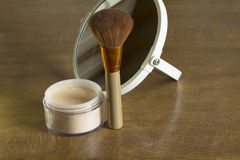 Cosmetic brush and loose powder Stock Image