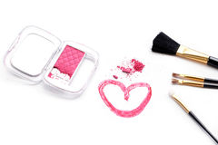 Cosmetic brush and pink powder on white background.  Stock Images