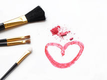 Cosmetic brush and pink powder on white background Stock Images