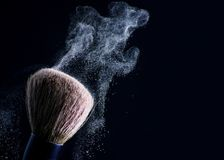 Professional cosmetic brush for powder. Cosmetic brush for powder on a black background Stock Photography