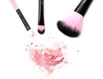 Cosmetic brush and powder isolated on white. Cosmetic brush and powder isolated on white Royalty Free Stock Image