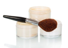 Cosmetic brush and powder jar of face isolated on white. Cosmetic brush and powder jar of face isolated on white background Royalty Free Stock Image