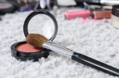 Cosmetic brush and powder. Cosmetic brush on and pink powder royalty free stock photography