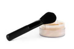 Cosmetic brush and powder Royalty Free Stock Photography