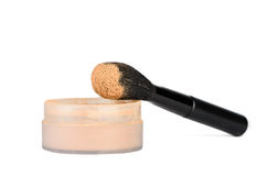 Cosmetic brush and powder Stock Image