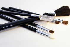 Cosmetic brushes. Close-up view of make-up brushes on white background Stock Image