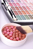 Cosmetic brushes. Brush , eye shadows and rouge  on white  background Stock Photos