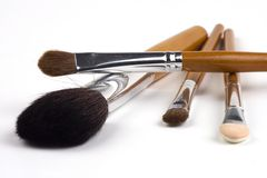 Cosmetic Brushes. Some cosmetic brushes in isolated white background Royalty Free Stock Photo