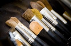 Cosmetic brushes. Close up of cosmetic brushes on black background Stock Photo