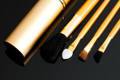 Cosmetic brushes on black Royalty Free Stock Photos