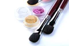 Cosmetic brushes and crumbly eyeshadows, close-up Royalty Free Stock Photography