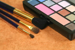 Cosmetic brushes and eye shadows Royalty Free Stock Image