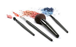 Cosmetic brushes and eyeshadows Stock Images