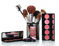 Cosmetic brushes, lip gloss, blush, eye shadow and powder . Stock Image