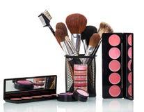 Cosmetic brushes, lip gloss, blush, eye shadow and powder . Stock Image