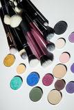 Cosmetic brushes and shadows Stock Image