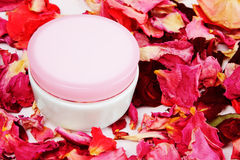 Cosmetic can and rose petals Royalty Free Stock Photography