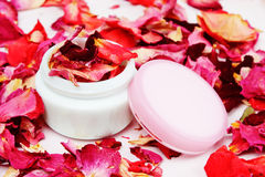 Cosmetic can and rose petals Stock Photos