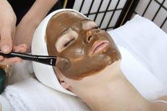 Cosmetic clay on fhe face Stock Photos