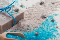 Cosmetic clay powder, homemade clay soap and blue sea salt on wh Stock Image