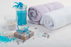 Cosmetic clay powder, homemade clay soap and blue sea salt on wh Royalty Free Stock Image